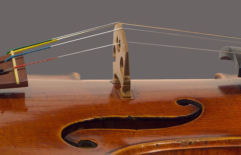 Bridge-foot veneers on a violin top